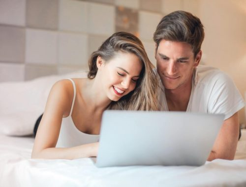 Young couple reviewing credit card grace period